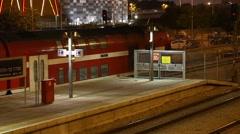 ASHDOD, ISRAEL-June 2016:railway station at night. train leaves the platform Stock Footage