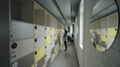 End of day in office, women can take personal belongings from lockers Stock Footage