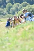 Family on a hiking day looking at vegetation Stock Photos