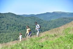 Family of four hiking in the mountain Stock Photos