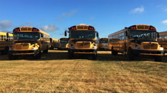 4K UltraHD A Close view of parked schoolbuses Stock Footage