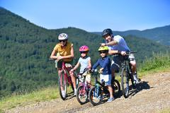 Family on a biking day, parents pointing at scenery Stock Photos