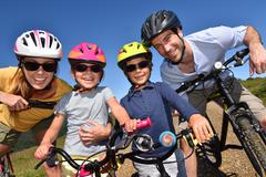 Portrait of happy family on a biking day Stock Photos