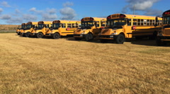 4K UltraHD A Motion controlled pan of parked schoolbuses Stock Footage