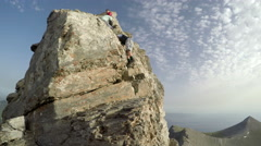 Rock climber on the top of Mytikas summit on Olympos mountain in Greece Stock Footage