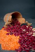 Group of beans, lentils and chick-pea  in wooden cup on black background. bea Stock Photos