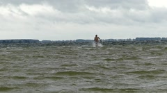 Young Boy Running on Water in Slow Motion. Stormy Weather. - stock footage