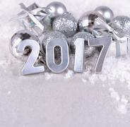 2017 year silver figures and silvery Christmas decorations - stock photo