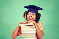 happy african bachelor girl with books at school - stock photo