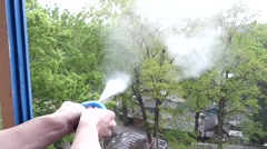Focus: the Hand Presses the Enema and it Emits Smoke From Talc. Slow Motion. Stock Footage