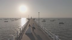 Bride and Groom Couple Walking on Pier in Slow Motion Aerial Shot Full HD 25p - stock footage