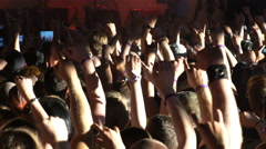 A lot of fans applauding and waving their hands at a rock concert. - stock footage