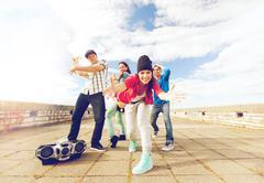 group of teenagers dancing - stock photo