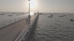 Bride and Groom Couple walking on Pier Sunset Aerial Shot Circling Full HD 25p - stock footage