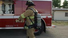 Fireman walking to fire truck Stock Footage