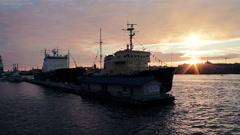 Icebreakers Moored In Saint-Petersburg City Lit By Orange Evening Sun Stock Footage