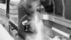 Old fashioned steam train wheels moving with smoke black and white Stock Footage