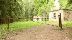 Barrier to the kids camp in the forest. Smooth and slow steady cam shot. - stock footage