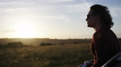 4K Handsome man in sunglasses enjoys the sunset view, in slow motion - stock footage