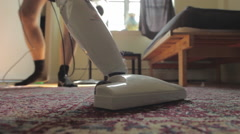 Man vacuums carpet in the early morning sun. Stock Footage