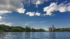 Moscow riversides, speedboat and dramatic summer clouds 4K hyperlapse wide shot - stock footage