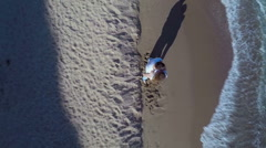 Man and woman stand on sea with several people which swim at summer sunny day Stock Footage