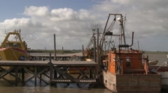 Boats moored to the quay of the river with sky background Stock Footage