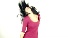 Beautiful girl full of energy dancing and singing isolated - stock footage