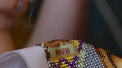 Fingers Girl Embroidered a Picture of the Beading Close Up. Stock Footage