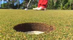 Slow motion golf ball putt Stock Footage