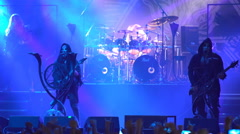 Black metal rock band Behemoth stands in front of a huge crowd of fans. - stock footage