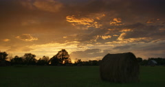 Hay Bale In A Farmer's Field At Sunset Stock Footage