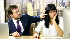 Boss harassing and bothering secretary in office Stock Footage