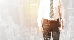 Business person with warm color overlay of city background Stock Photos
