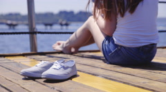 Beautiful canvas shoes on wooden pier 4K Stock Footage
