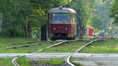 The Tram Rides on the Tram Tracks, and the Cars Are Moving His Way. Stock Footage