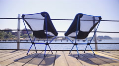 Compact textile chairs on pier at sea side 4K Stock Footage