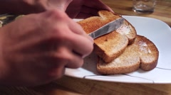 Buttering Toast - stock footage