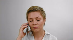 Excited blond woman emotionally talking by phone Stock Footage