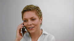 Short hair blond woman talks by mobile phone - stock footage