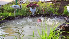 Child have fun splashing in the water Stock Footage