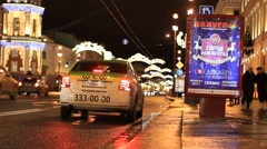 Taxi car driving away at night Stock Footage