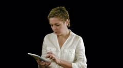 Short hair business woman texting on tablet pad - stock footage