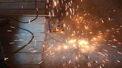 Flashes and lot of sparks from welding work at construction site in dark Stock Footage