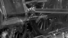 Steam train wheels turning in black and white old shot Stock Footage