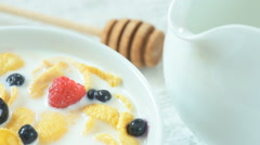 Ready to eat breakfast- cereals with milk and berries Stock Footage