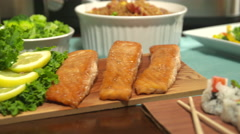 Salmon Move Left to Pork Roast Stock Footage