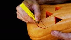 Master cutting jack-o-lantern out of pumpkin 3. Stock Footage