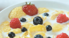 Traditional american breakfast - cereals with milk and fruits - stock footage