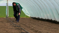 Setting up irrigation systems in greenhouses. Stock Footage